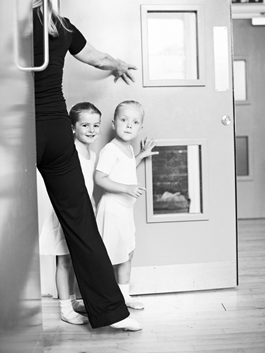 Primary school age ballet dancers arriving for their lesson