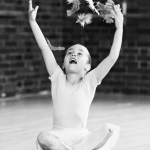 Child taking part in pre-school ballet lesson